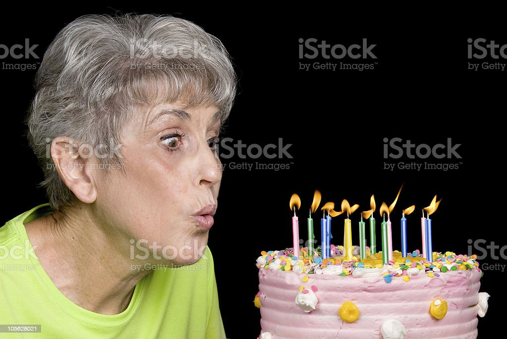 Adult blowing out candles royalty-free stock photo