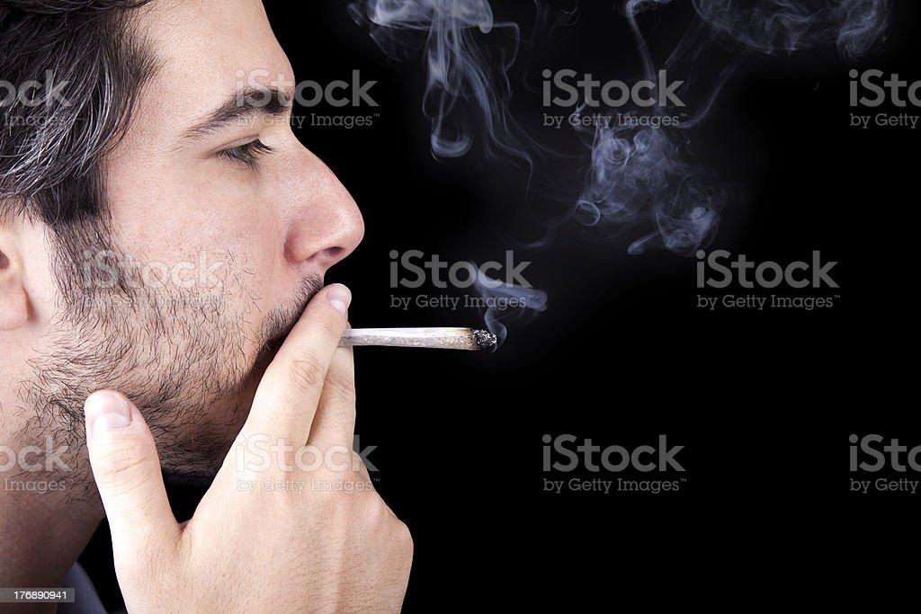Adult Bum Smoking a Spliff stock photo