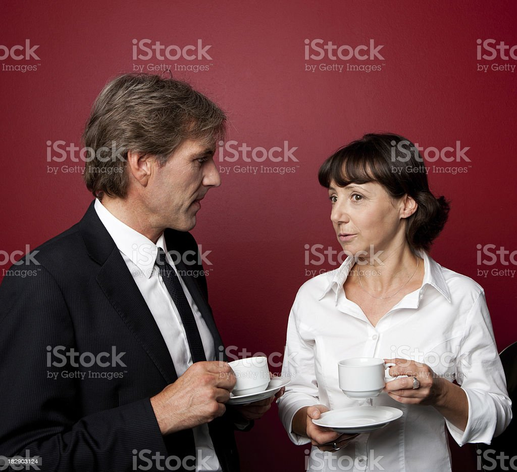 Adult Business Couple Drinking Coffee and Talking royalty-free stock photo