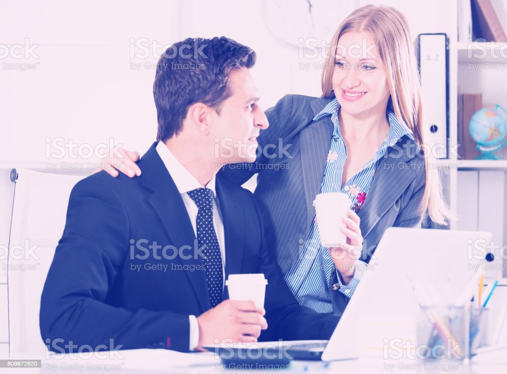 Adult business couple flirting in office stock photo