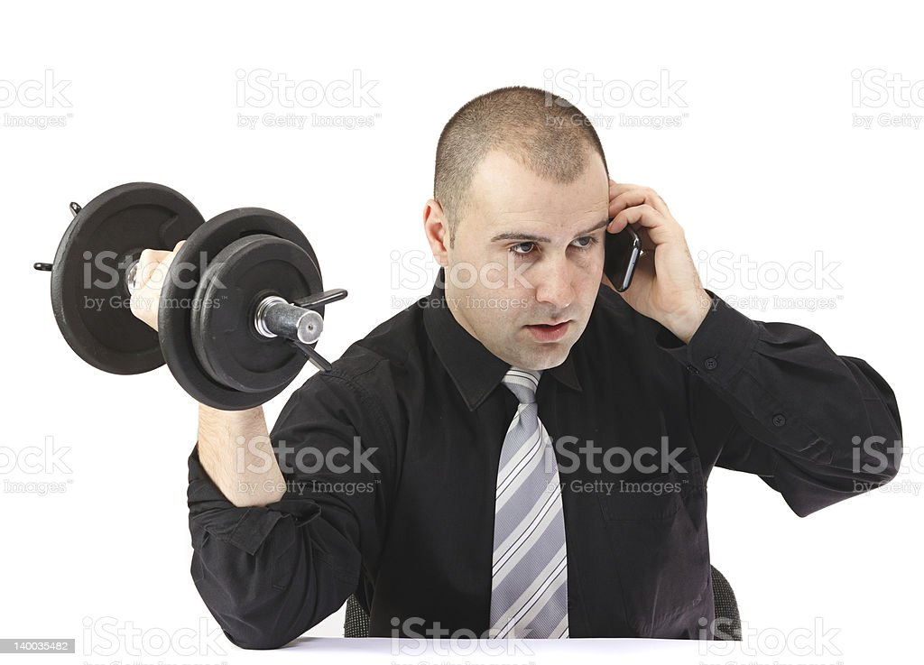 Adult business man on the phone doing fitness at work royalty-free stock photo