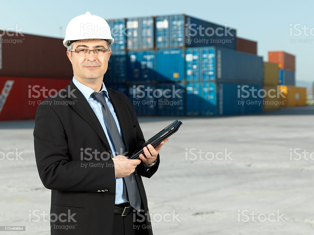 Adult Businessman in Container Warehouse royalty-free stock photo