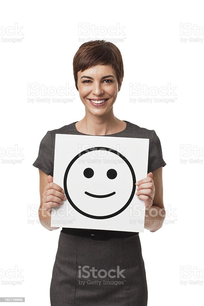 Adult Businesswoman Holding Happy Face Drawing Isolated on White royalty-free stock photo