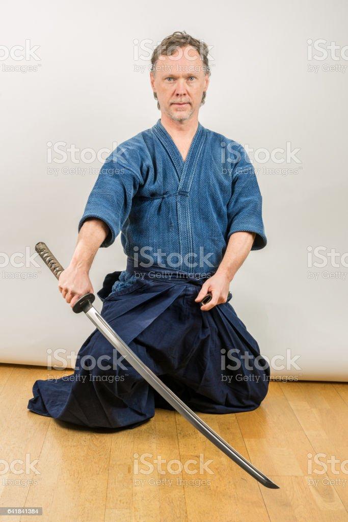 Adult caucasian male training Japanese sport iaido. stock photo