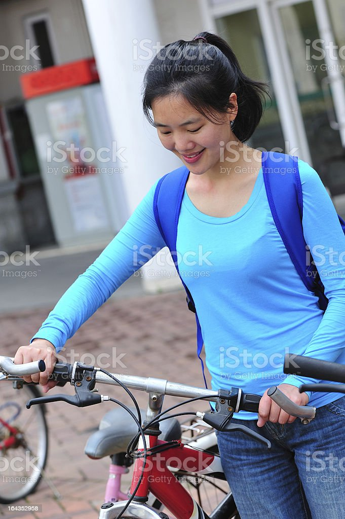 adult college student with her bike royalty-free stock photo