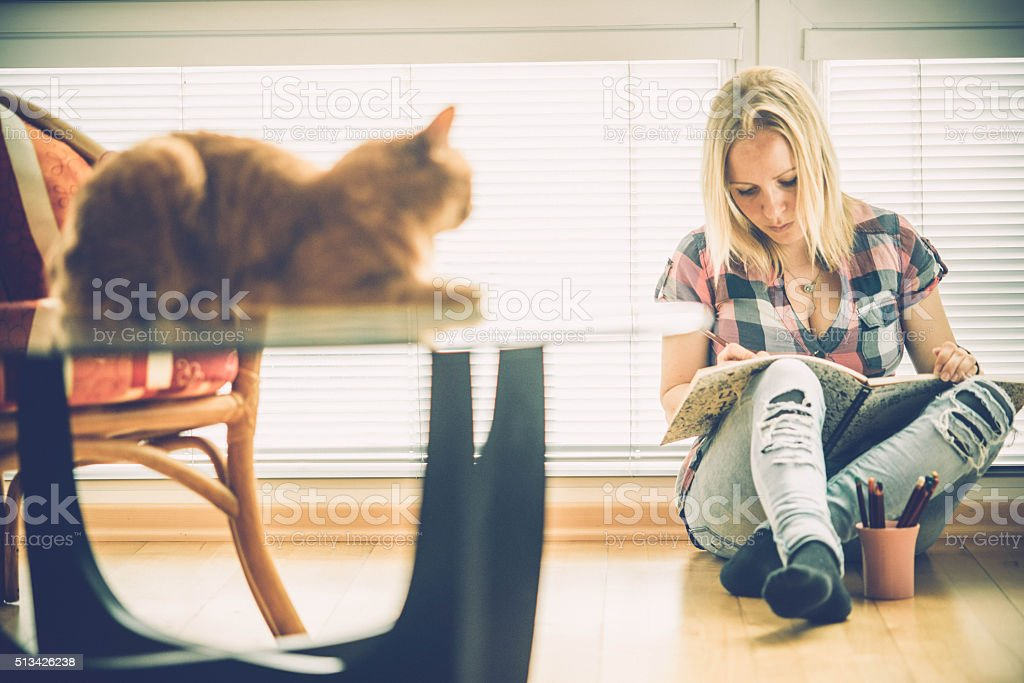 Adult Coloring Books - blonde woman relaxing at home stock photo
