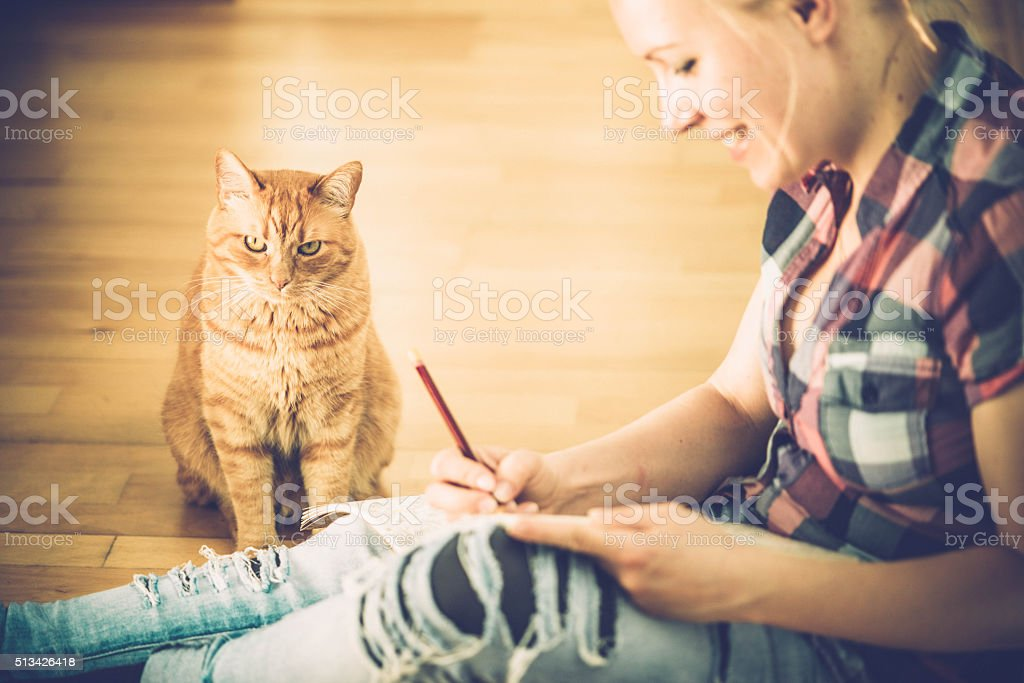 Adult Coloring Books - Ginger cat and blonde woman stock photo