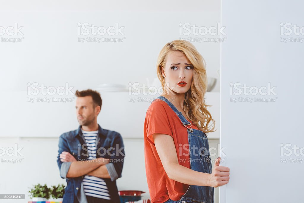 Adult couple after argument, focus on worried woman stock photo