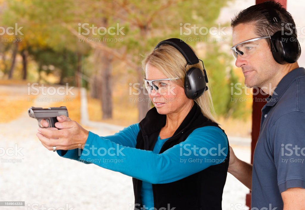 Adult Couple at the Shooting Range stock photo