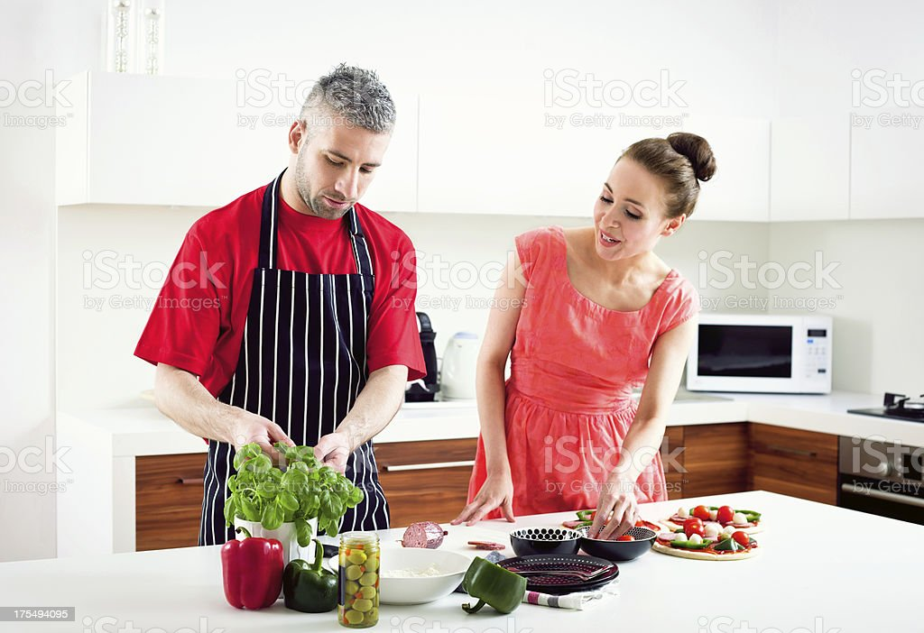 Adult Couple Cooking Homemade Pizza royalty-free stock photo