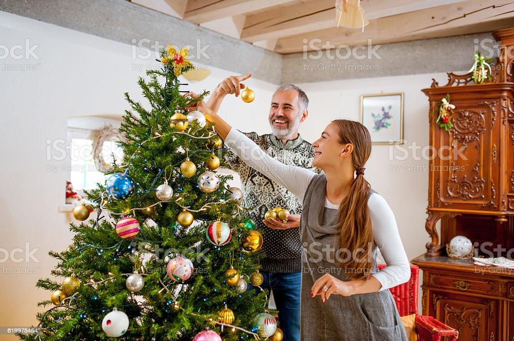 Adult Couple Decorating the Christmas Tree stock photo