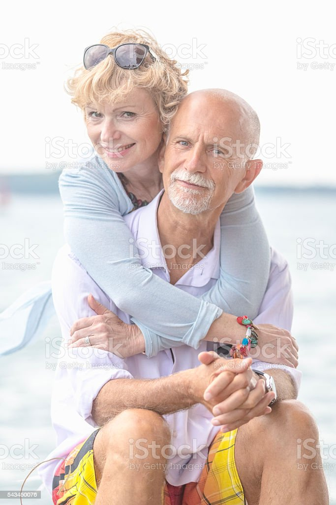 Adult couple embracing stock photo