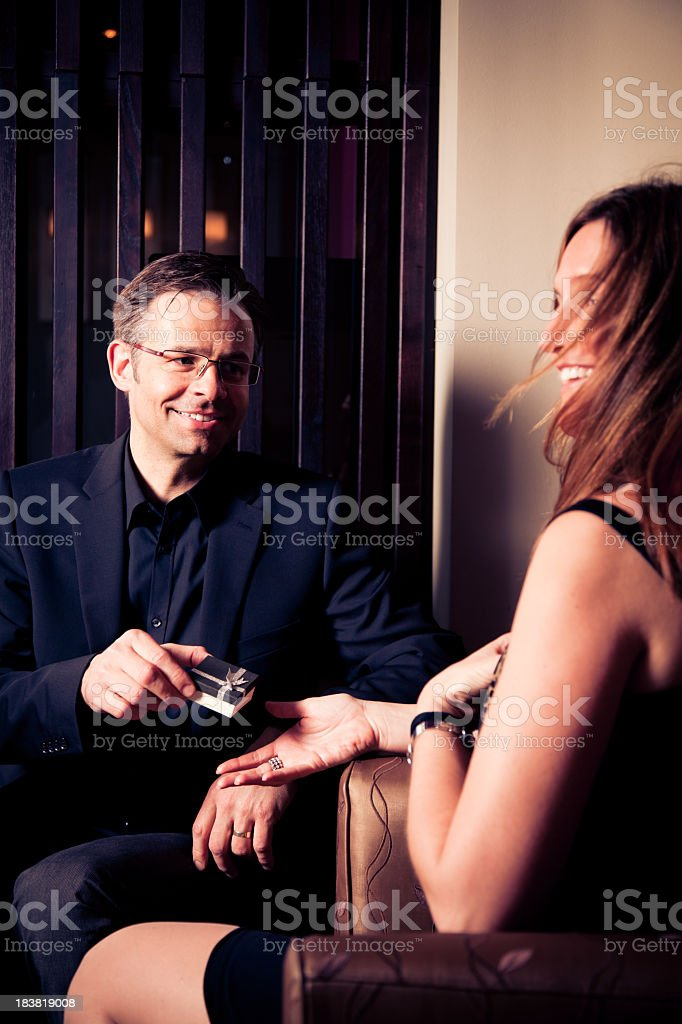 adult couple having a glass of wine royalty-free stock photo