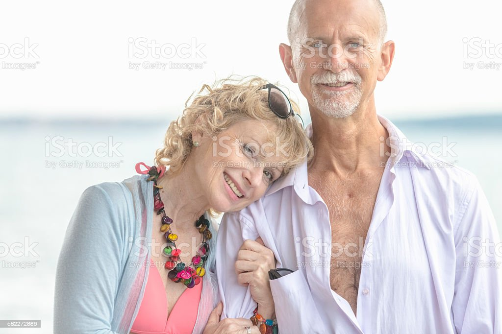 Adult couple hug together stock photo