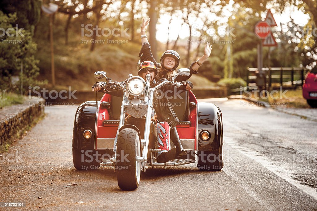 Adult Couple on Trike Enjoying a ride at Sunset stock photo