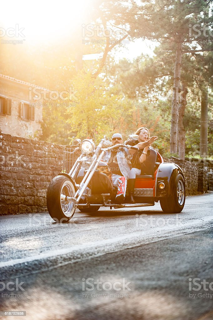 Adult Couple on Trike enjoying a ride. stock photo