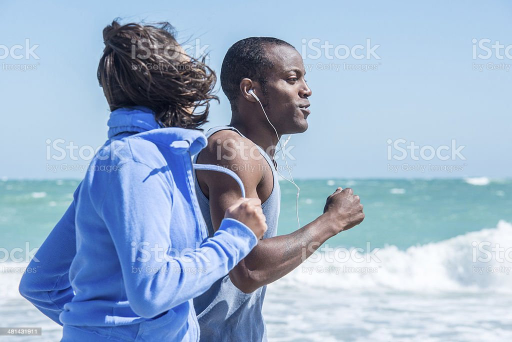 Adult Couple Running on Vero Beach stock photo