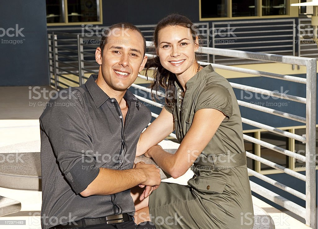 Adult Couple Sitting Outdoors royalty-free stock photo