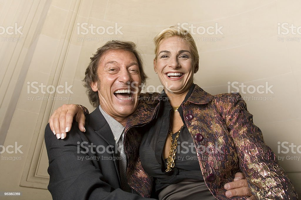 Adult couple smiling into camera stock photo