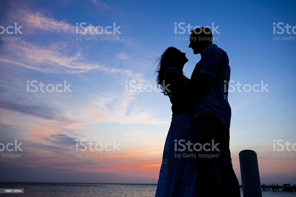 Adult Couple Sunset Silhouette royalty-free stock photo