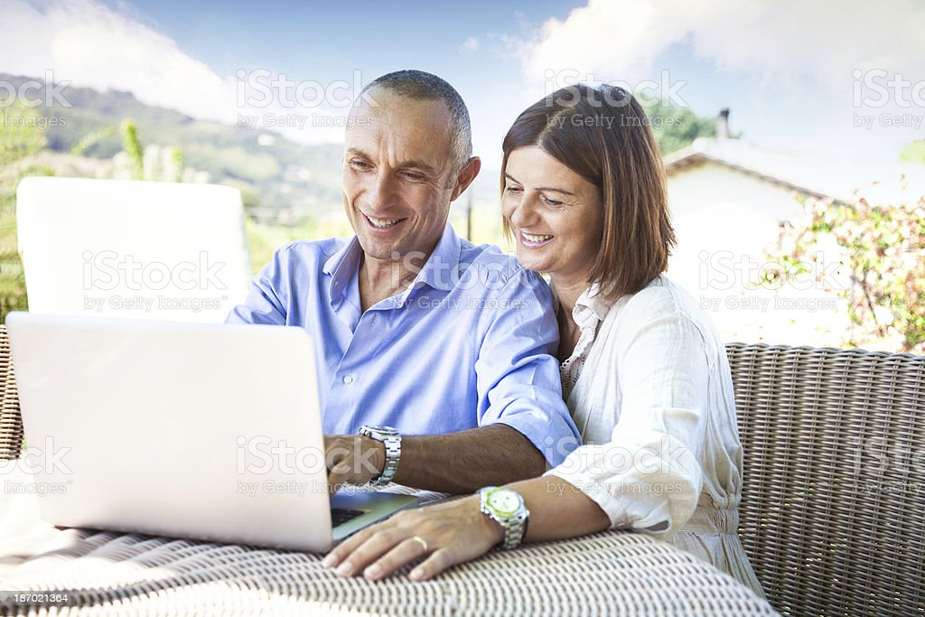 Adult couple surfing the net on computer royalty-free stock photo