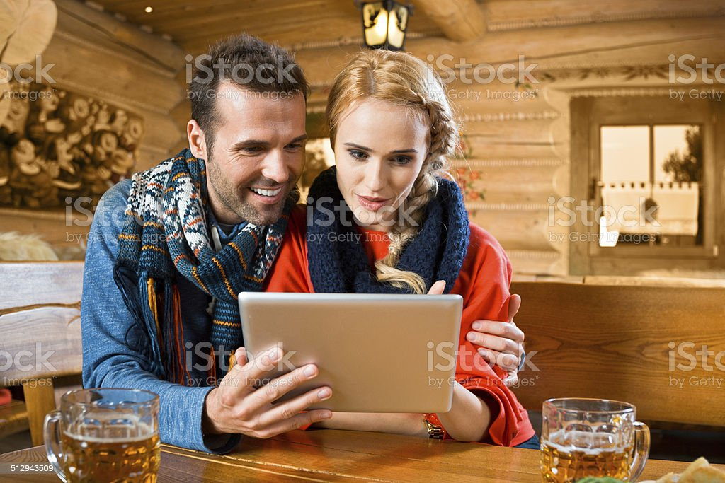 Adult couple using digital tablet stock photo