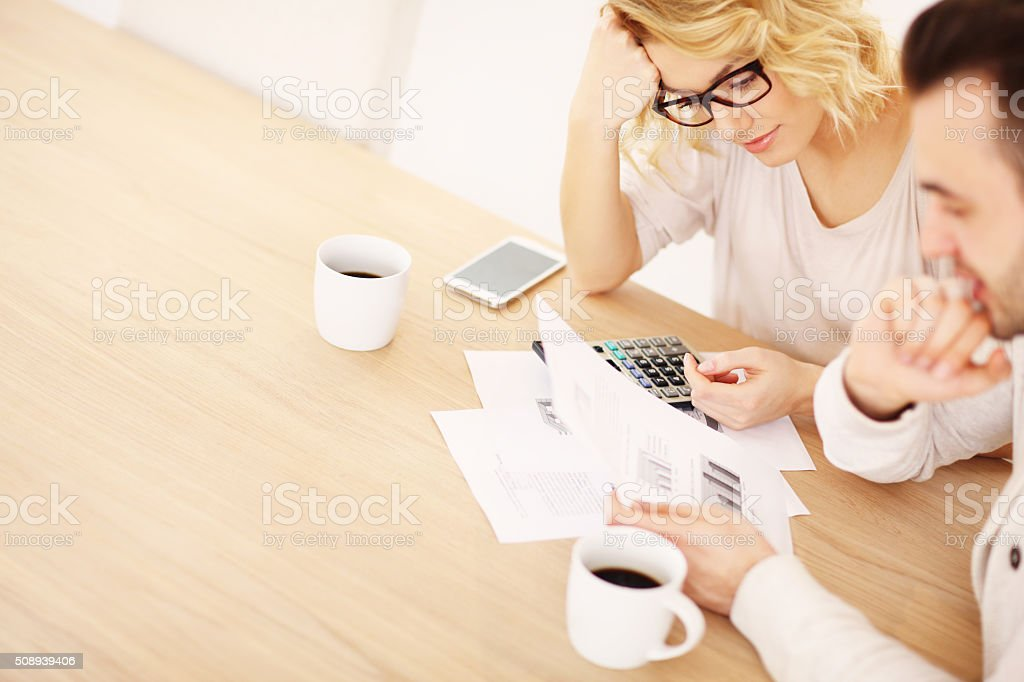 Adult couple working on documents stock photo