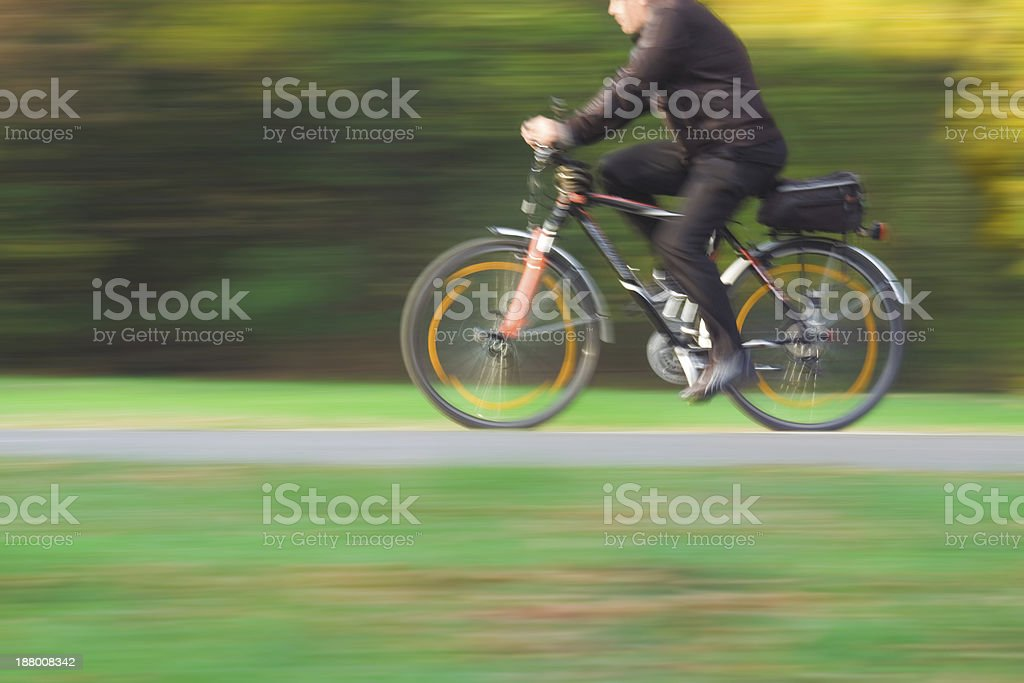 Adult Cyclist in Blurred Motion stock photo