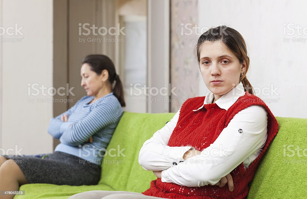 Adult daughter and mother after quarrel stock photo