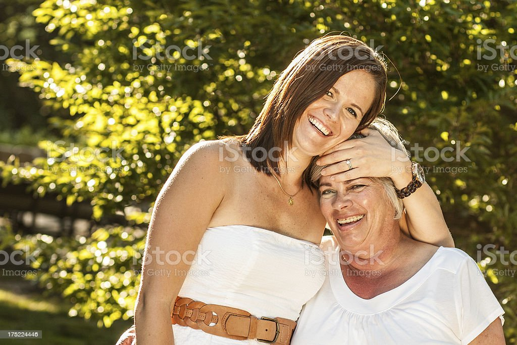Adult Daughter Embraces Mother on Summer Day royalty-free stock photo