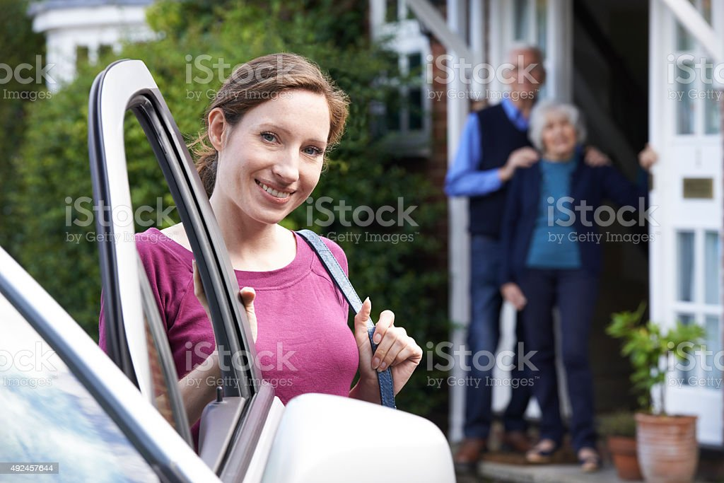 Adult Daughter Visiting Senior Parents At Home stock photo