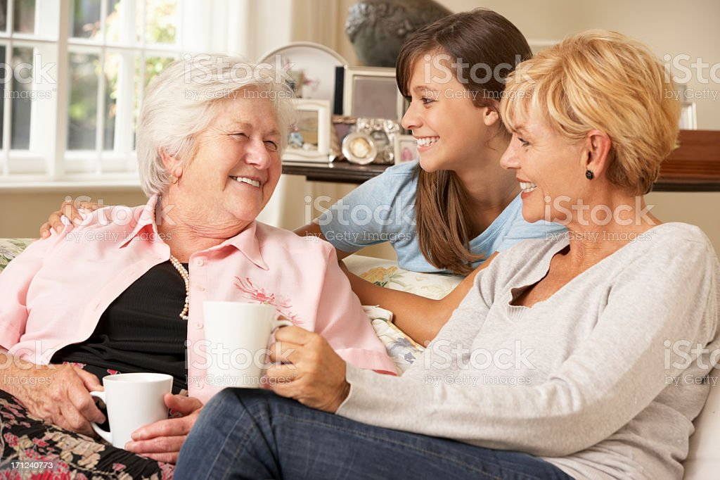 Adult Daughter With Teenage Granddaughter Visiting Grandmother stock photo