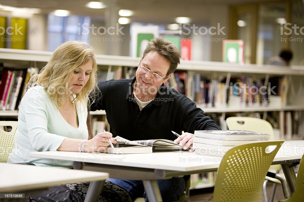 adult education: a couple of mature students studying together stock photo