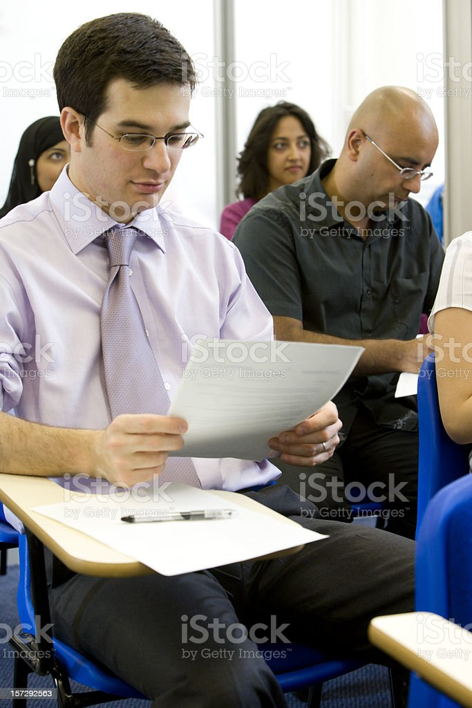 adult education: diverse mature students under exam conditions royalty-free stock photo