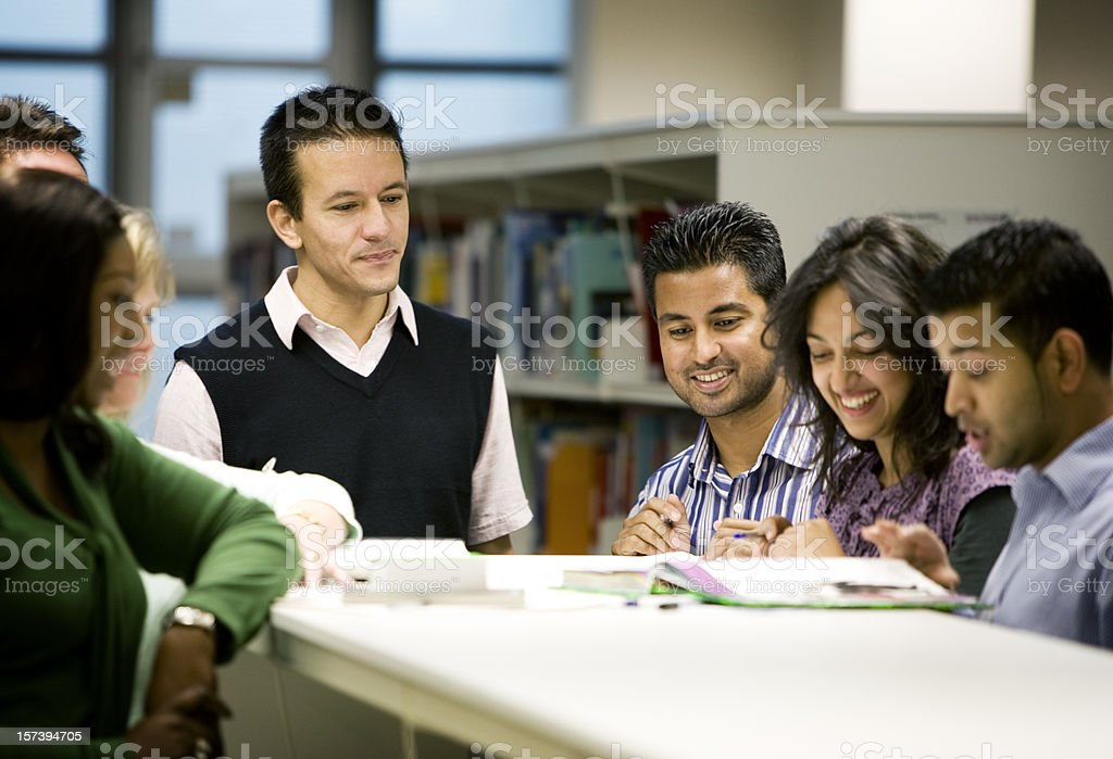 adult education: diverse mature students working on a group project stock photo