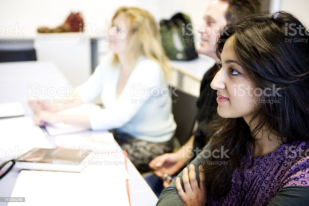 adult education: eager students listening intently to their class teacher royalty-free stock photo