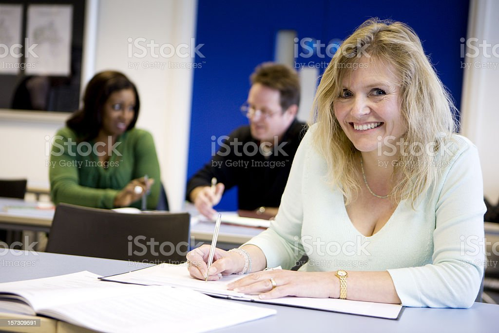 adult education: eye contact from a friendly mature student stock photo
