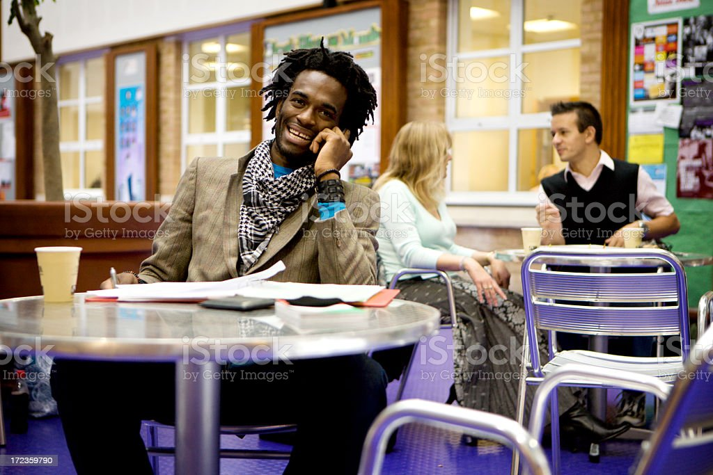adult education: mature student making a phone call royalty-free stock photo