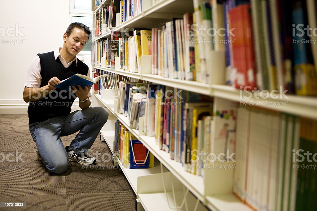 adult education: mature student using his college reference library royalty-free stock photo