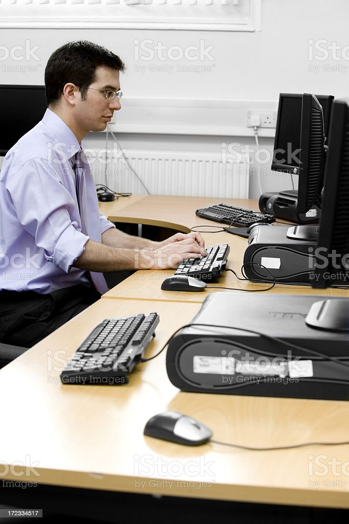 adult education: mature student working at his desk royalty-free stock photo