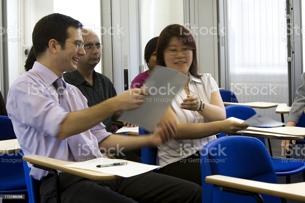 adult education: mature students about to begin an exam royalty-free stock photo