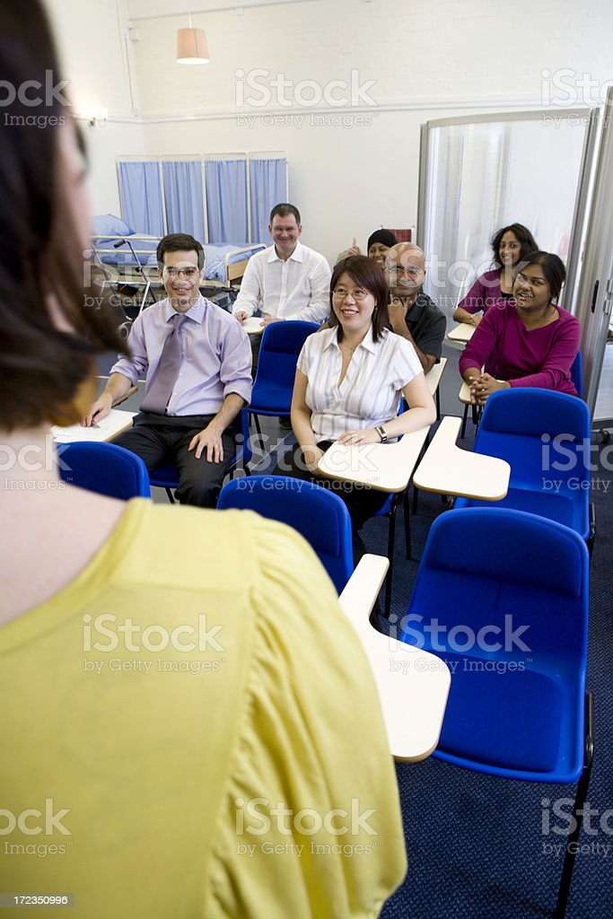 adult education: medical students listening to their teacher royalty-free stock photo