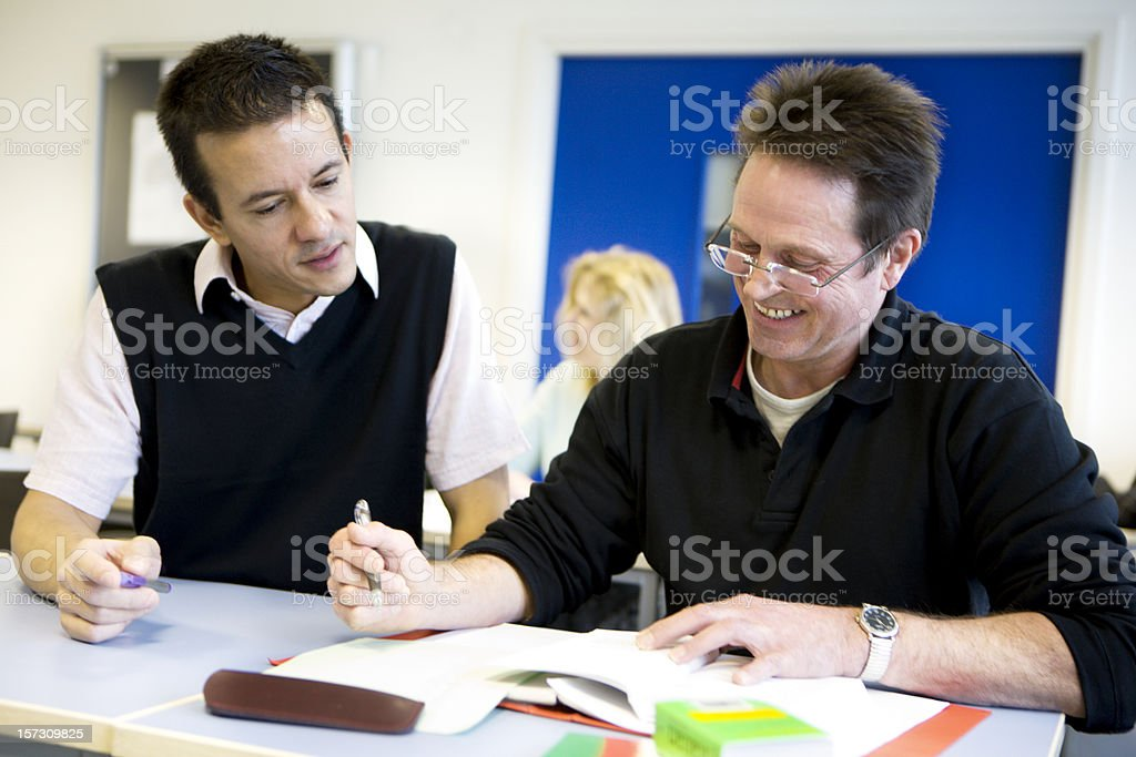adult education: private tuition between a mature student and teacher royalty-free stock photo