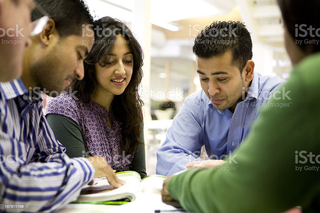 adult education: South Asian mature students working together in class stock photo