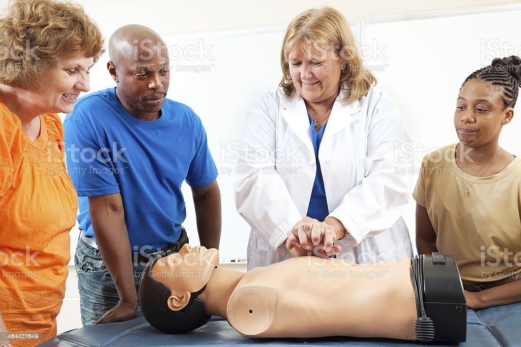Adult Education Students Learn CPR stock photo