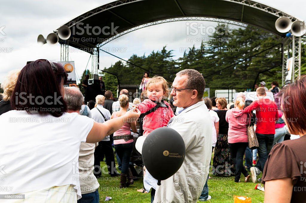 adult feeds child at the festival royalty-free stock photo
