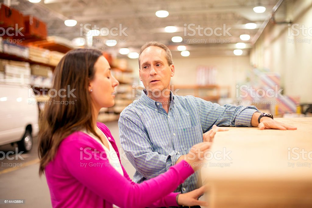 Adult female gets help from a store employee stock photo