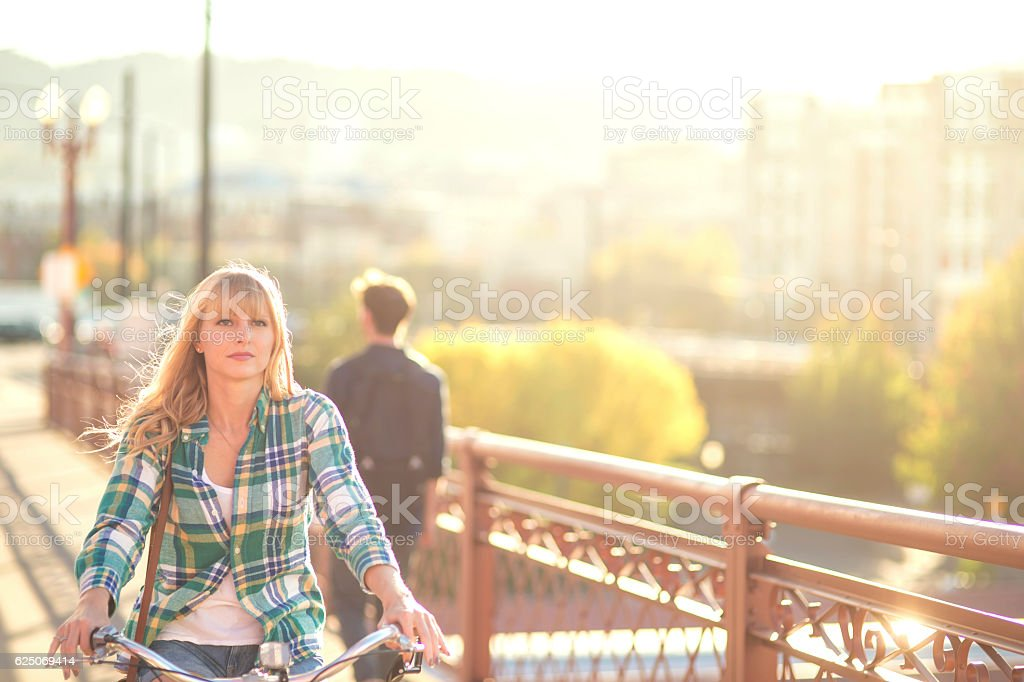 Adult female riding away after a bad date stock photo