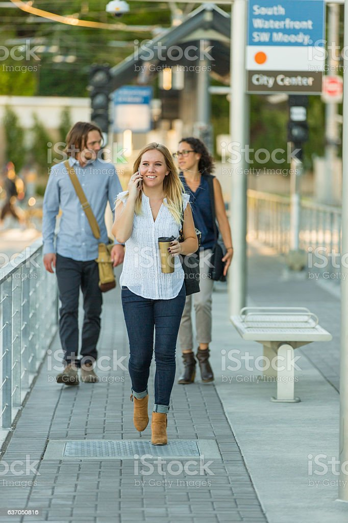 Adult female talking on phone and drinking coffee stock photo