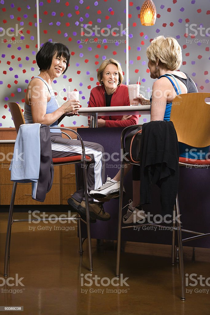 Adult females sitting at table in health club. royalty-free stock photo